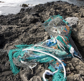 Lost fishing gear washed up on rocky shore