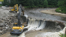 Heavy equipment removes the Merrimack Village Dam in New Hampshire